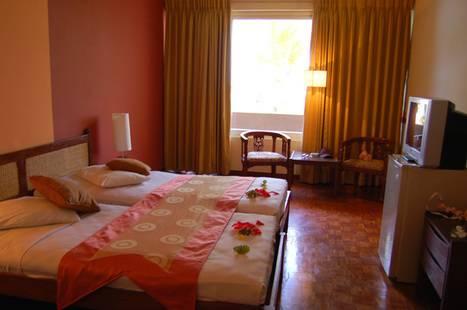 Palm Village Hotel